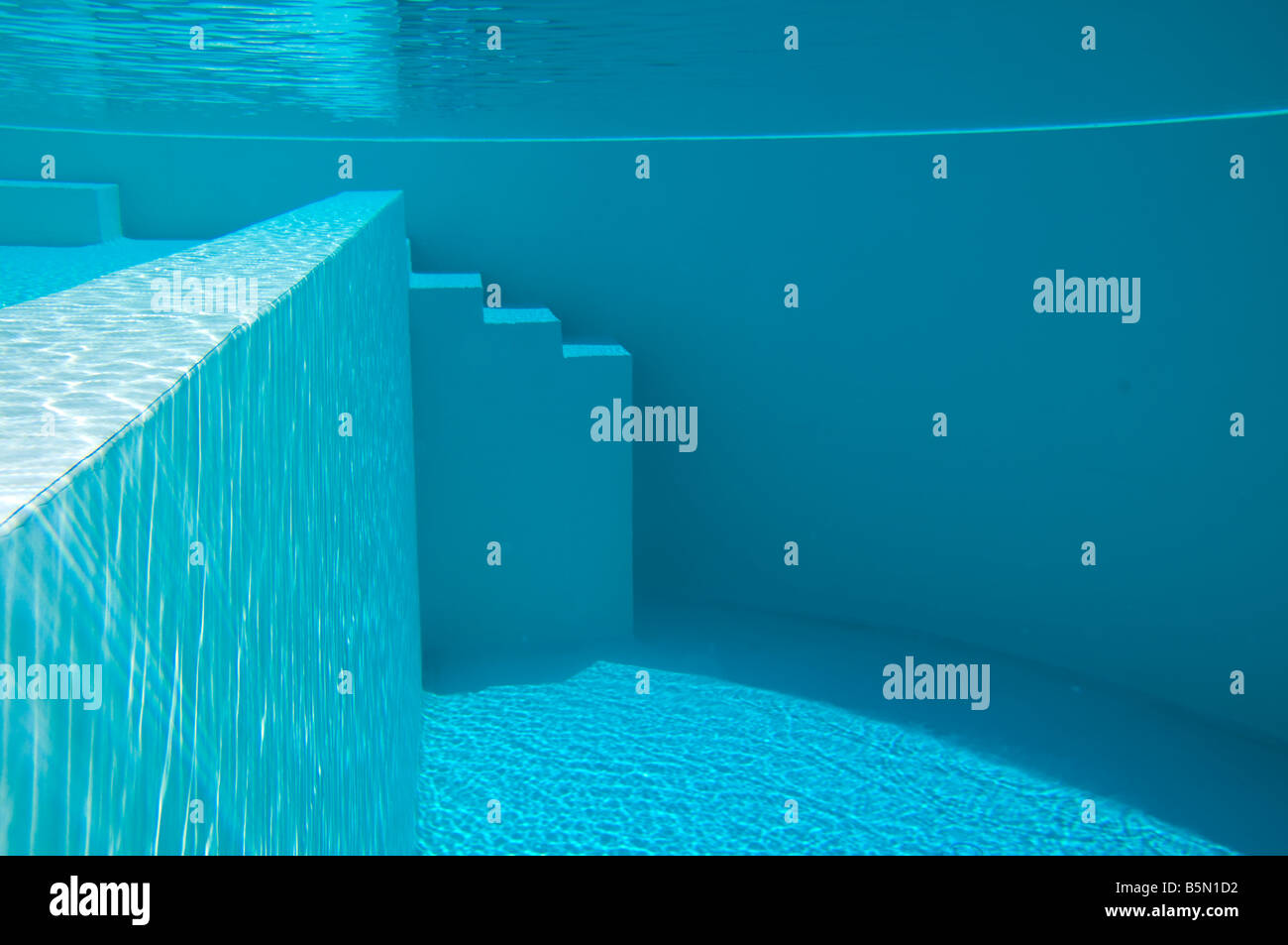 A swimming pool seen underwater. - Stock Image
