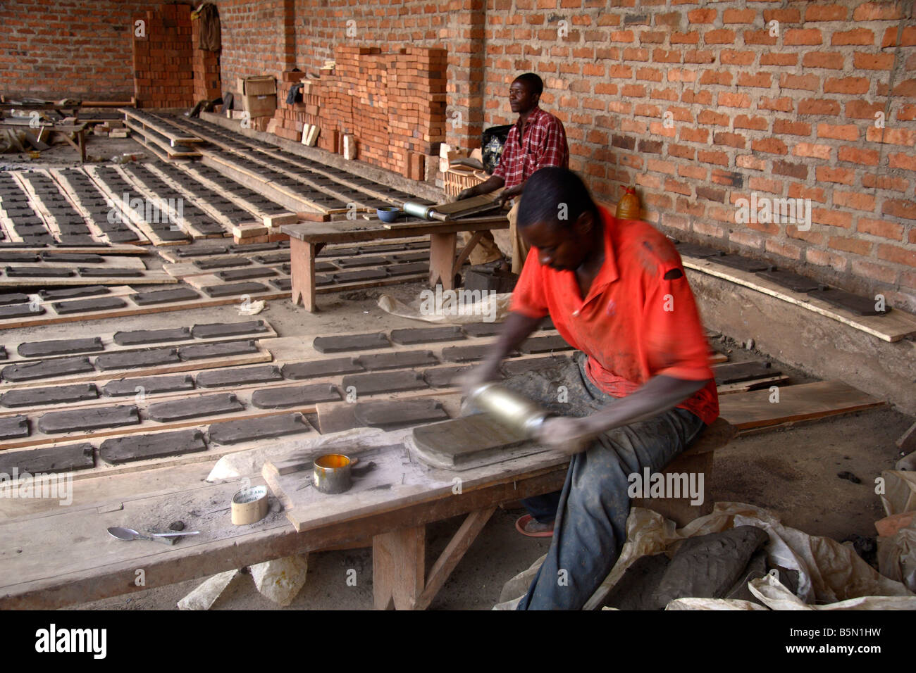 Making roof tiles at Prespot pottery works Bamessing Northwest Province Cameroon West Africa Small industry in rural - Stock Image