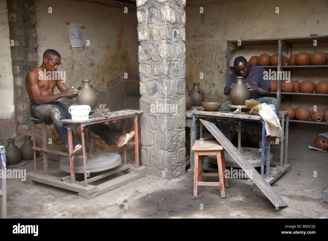 Pottery workers throwing pots at Prespot pottery works Bamessing Northwest Province Cameroon - Stock Image