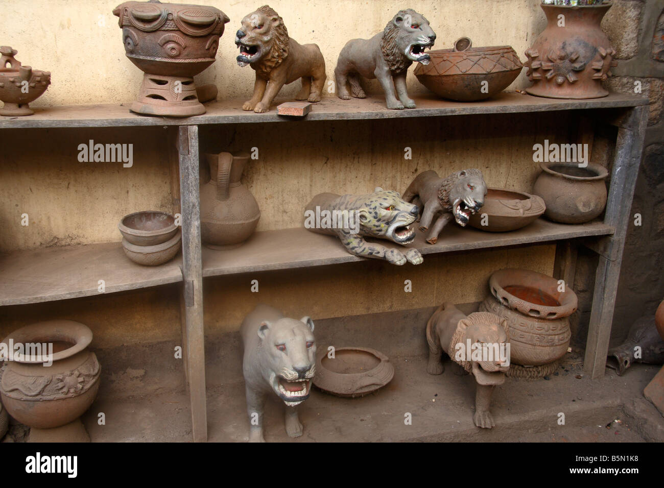 Ceramic animals and pots on display at Prespot pottery works Bamessing Northwest Province Cameroon - Stock Image