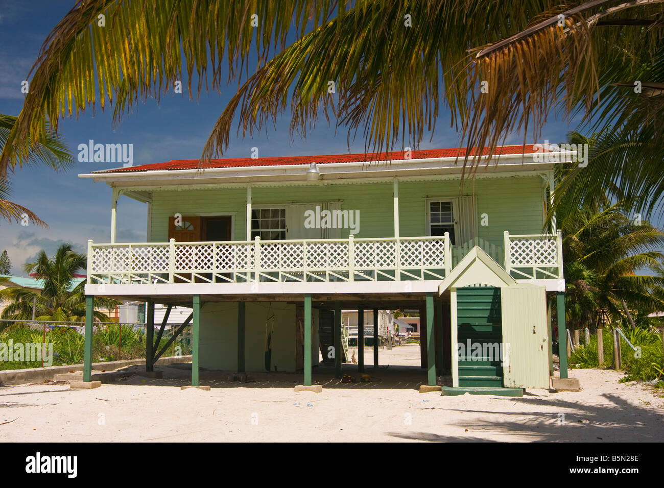 Wonderful CAYE CAULKER BELIZE Wooden House On Stilts On Sand Beach With Palm Trees