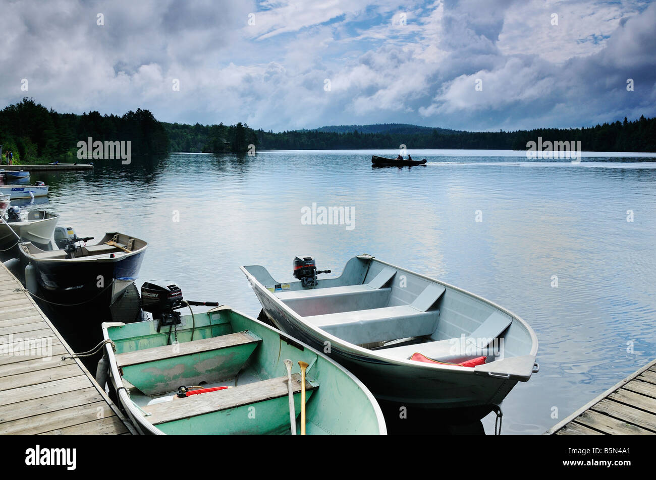 Boats anchored in a lake in Algonquin Provincial Park Ontario Canada - Stock Image