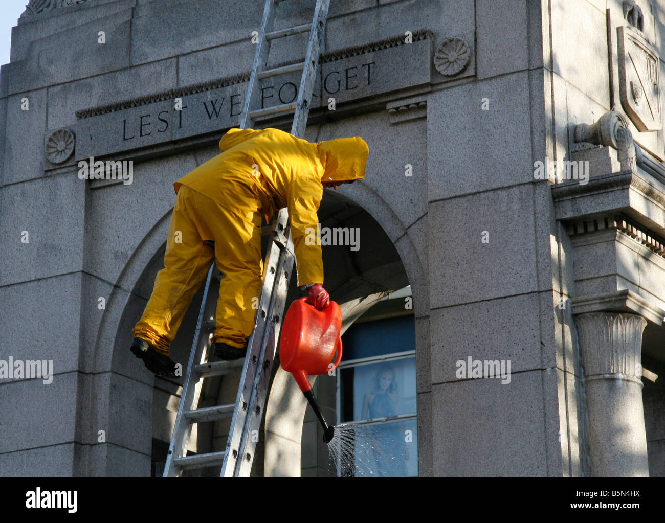 Council Worker Cleaning The Cenotaph in Bolton Lancashire UK Stock Photo