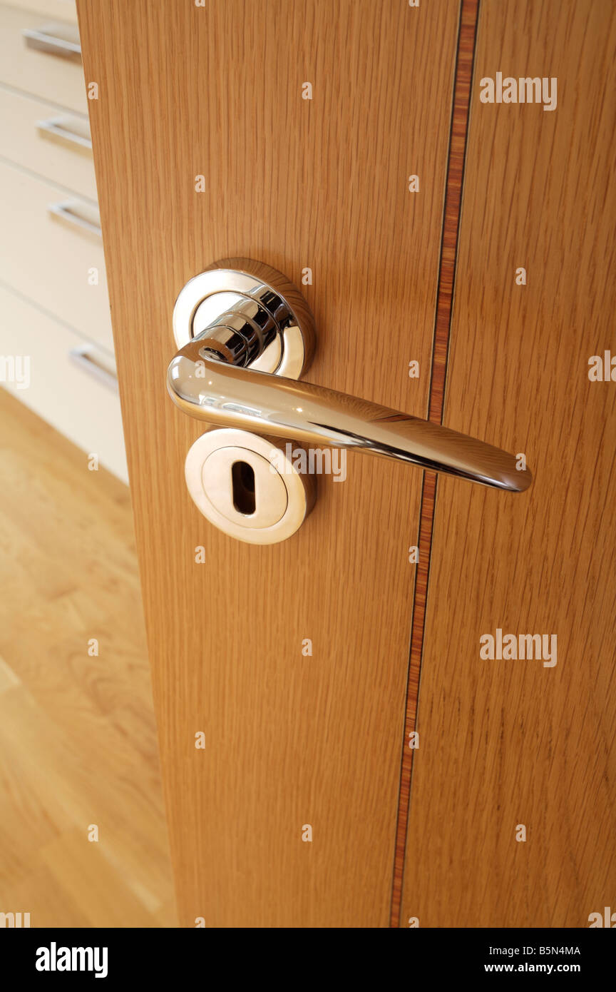 Chrome plated door handle and escutcheon on an inlaid oak veneered door in a luxury apartment & Escutcheon Stock Photos u0026 Escutcheon Stock Images - Alamy