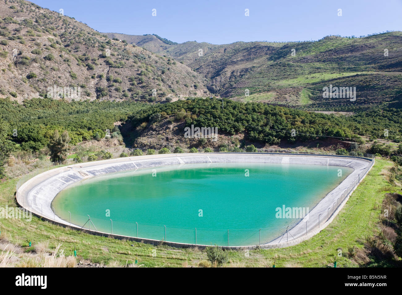 Farm reservoir near Casabermeja Malaga Province Spain - Stock Image