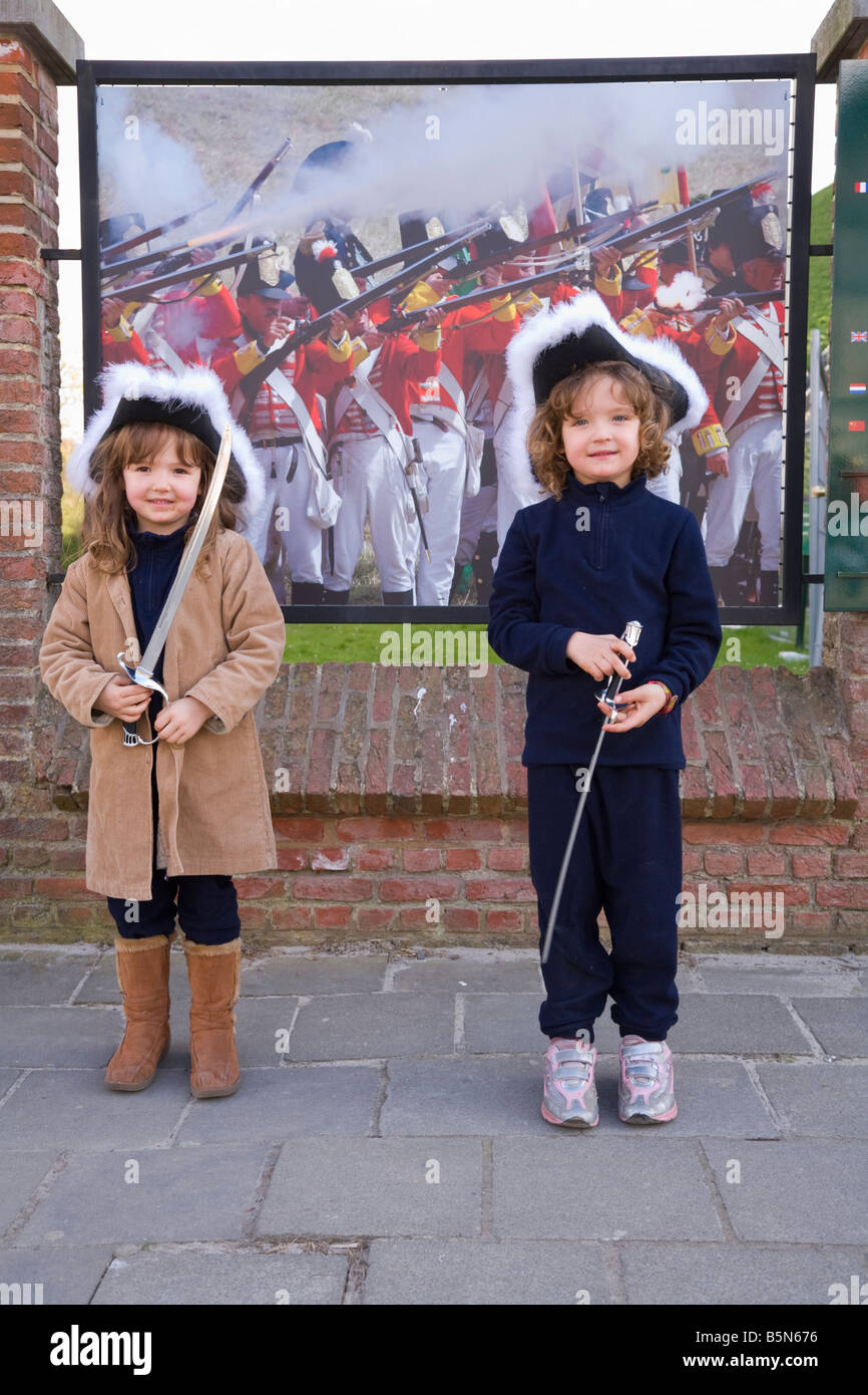 Children with period hats and swords outside the visitors' centre at the site of the Battle of Waterloo. Waterloo. - Stock Image