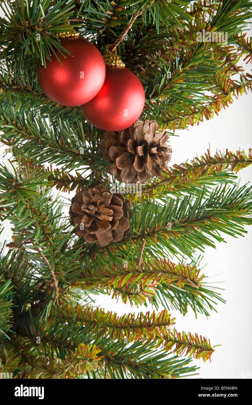 Christmas garland with red baubles and pine cones - Stock Image