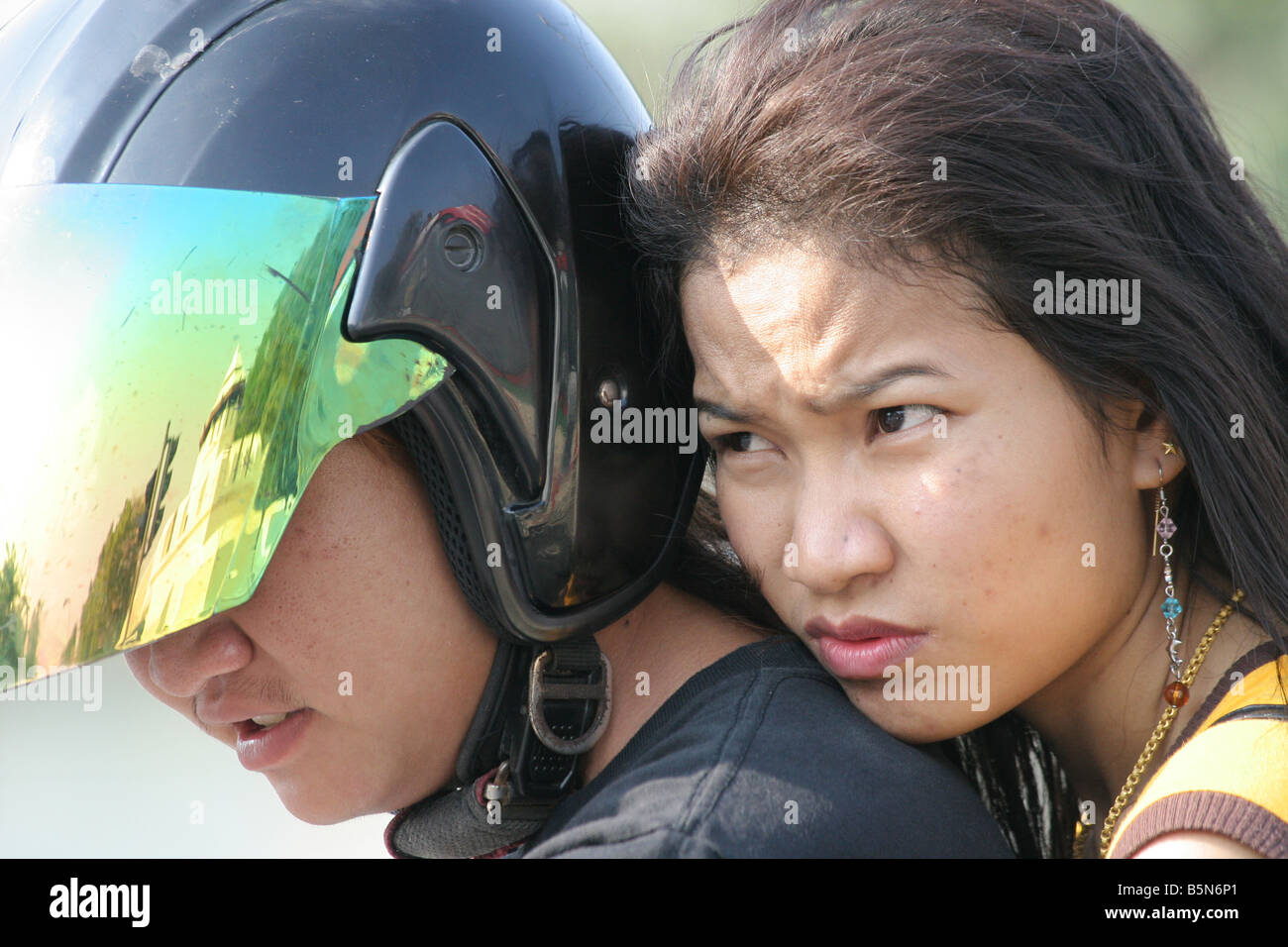 young thai couple portrait on motorcycle, bangkok, Thailand Stock Photo