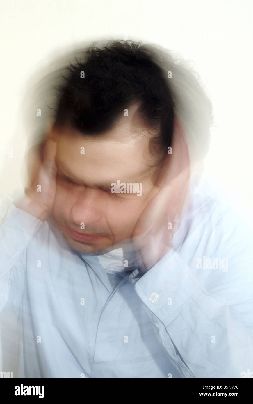 A man with a blurred face - Stock Image