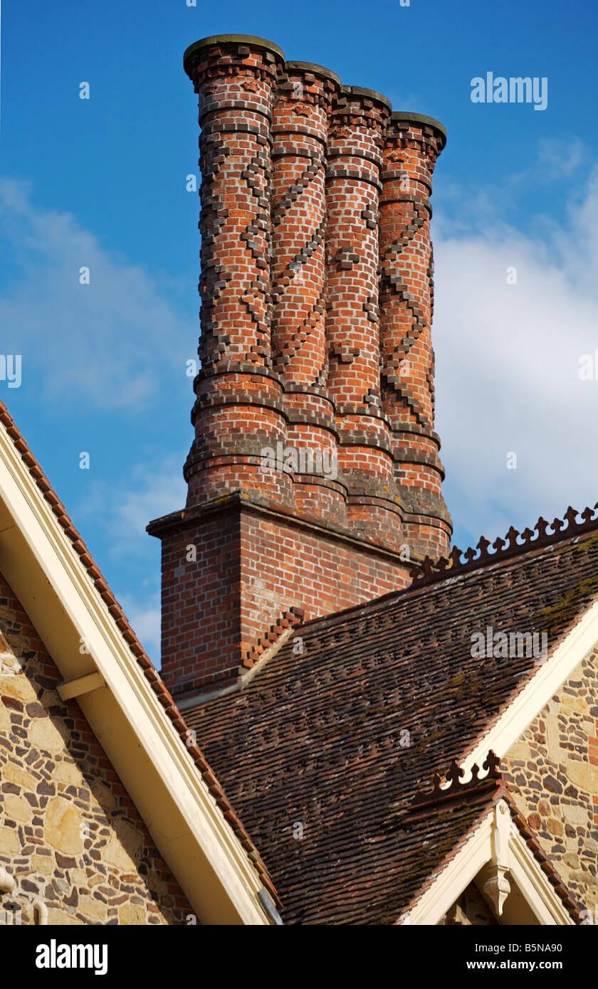 Ornate brickwork Pugin chimneys on a house in Albury, Surrey - Stock Image