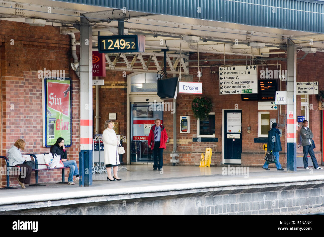 Passengers waiting for trains at Doncaster railway station, 'South Yorkshire, England, 'Great Britain' - Stock Image