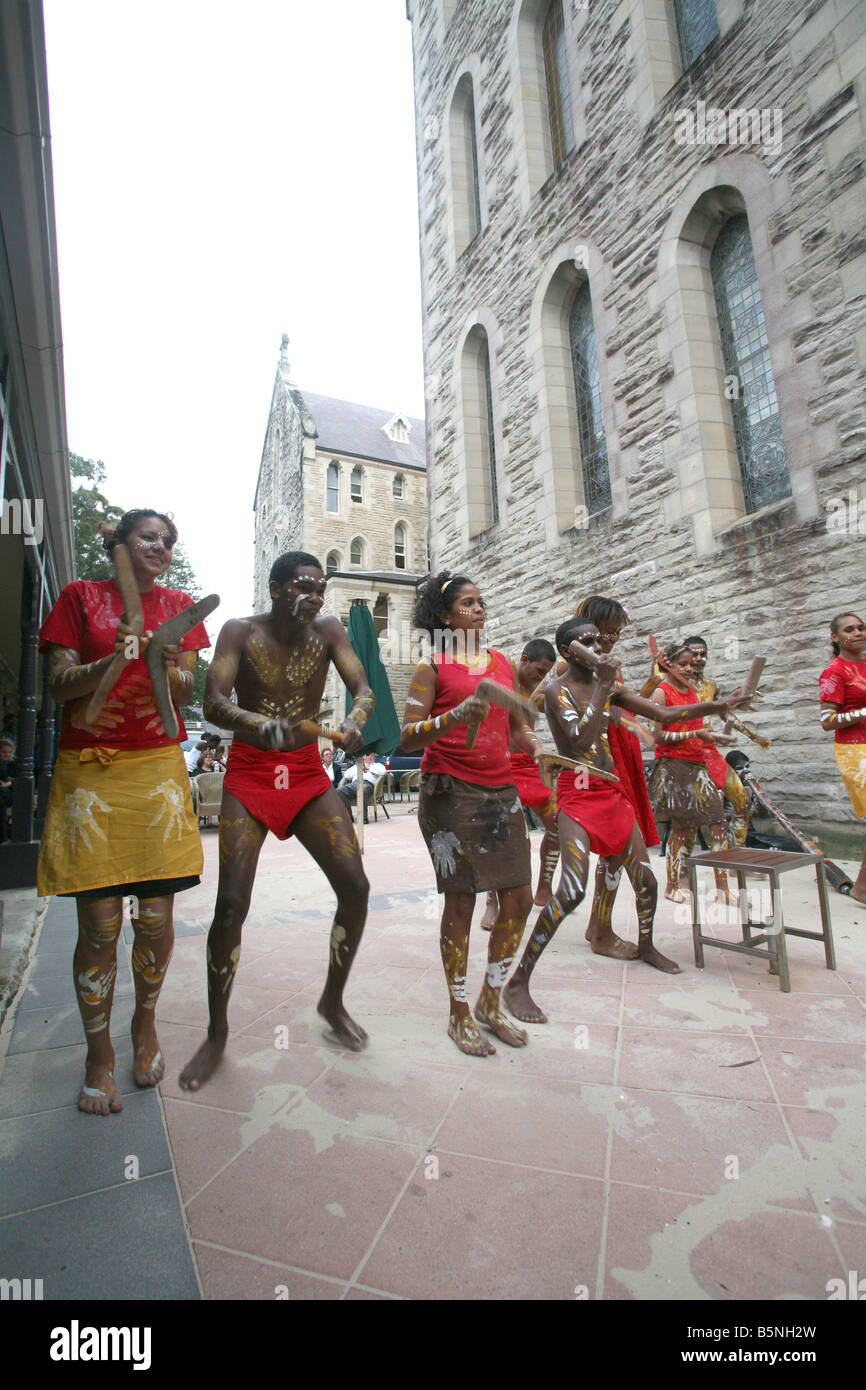 Indigenous Australian students dance during a cultural performance at the Manly International Hotel School - Stock Image