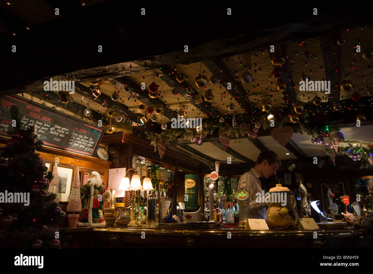 Christmas at the village pub - Stock Image