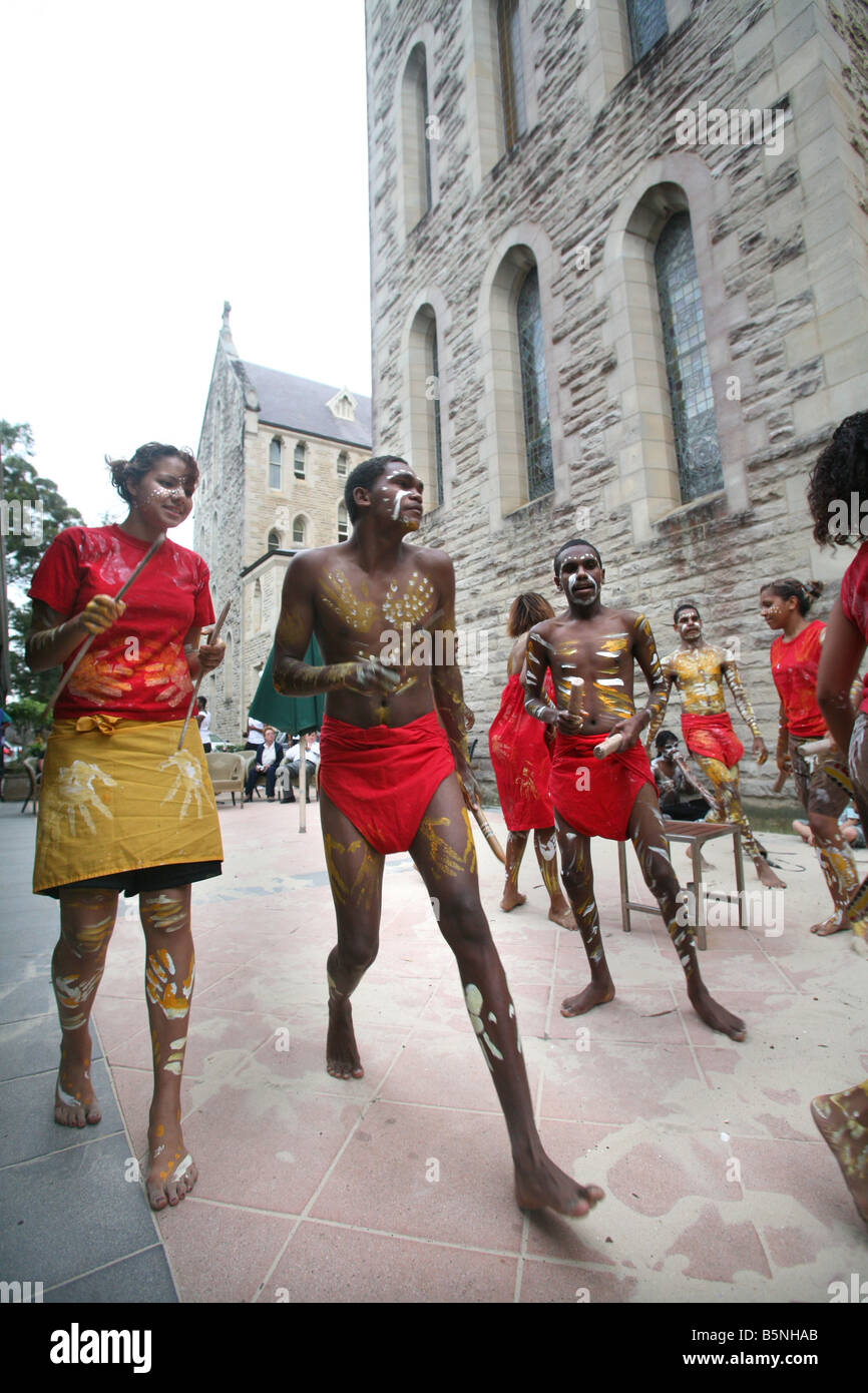 Indigenous Australian students show their dance moves cultural performance at the Manly International Hotel School - Stock Image