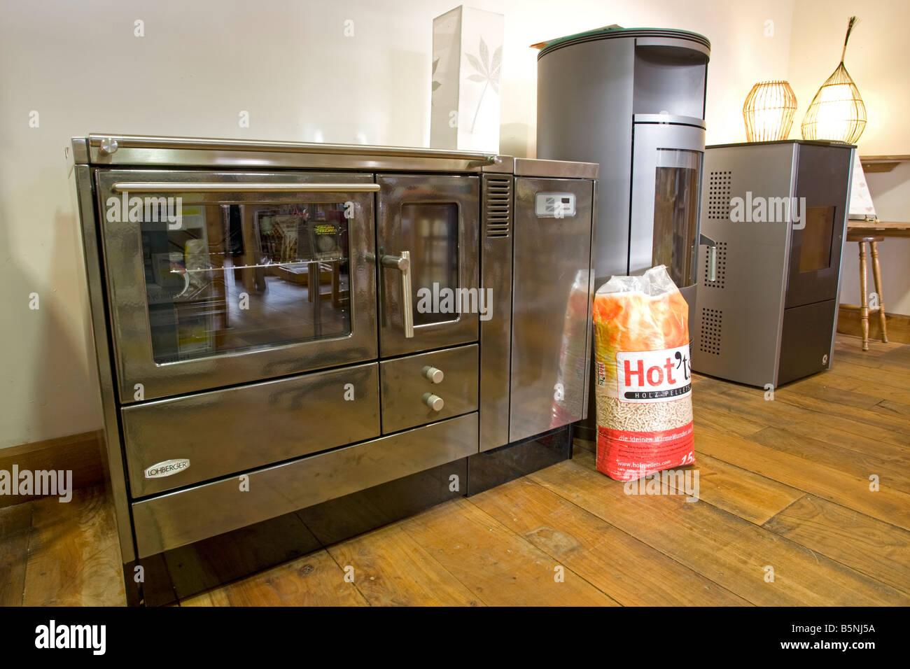 Modern German stainless steel wood pellet cooking and heating stoves Green Shop Bisley UK - Stock Image