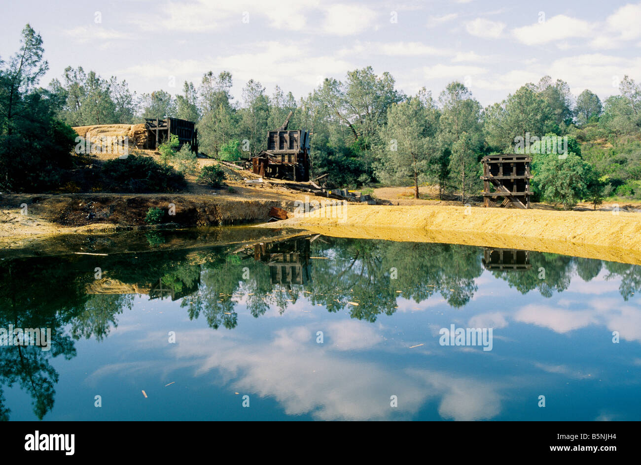 Abandoned copper mine, waste settling pond. - Stock Image
