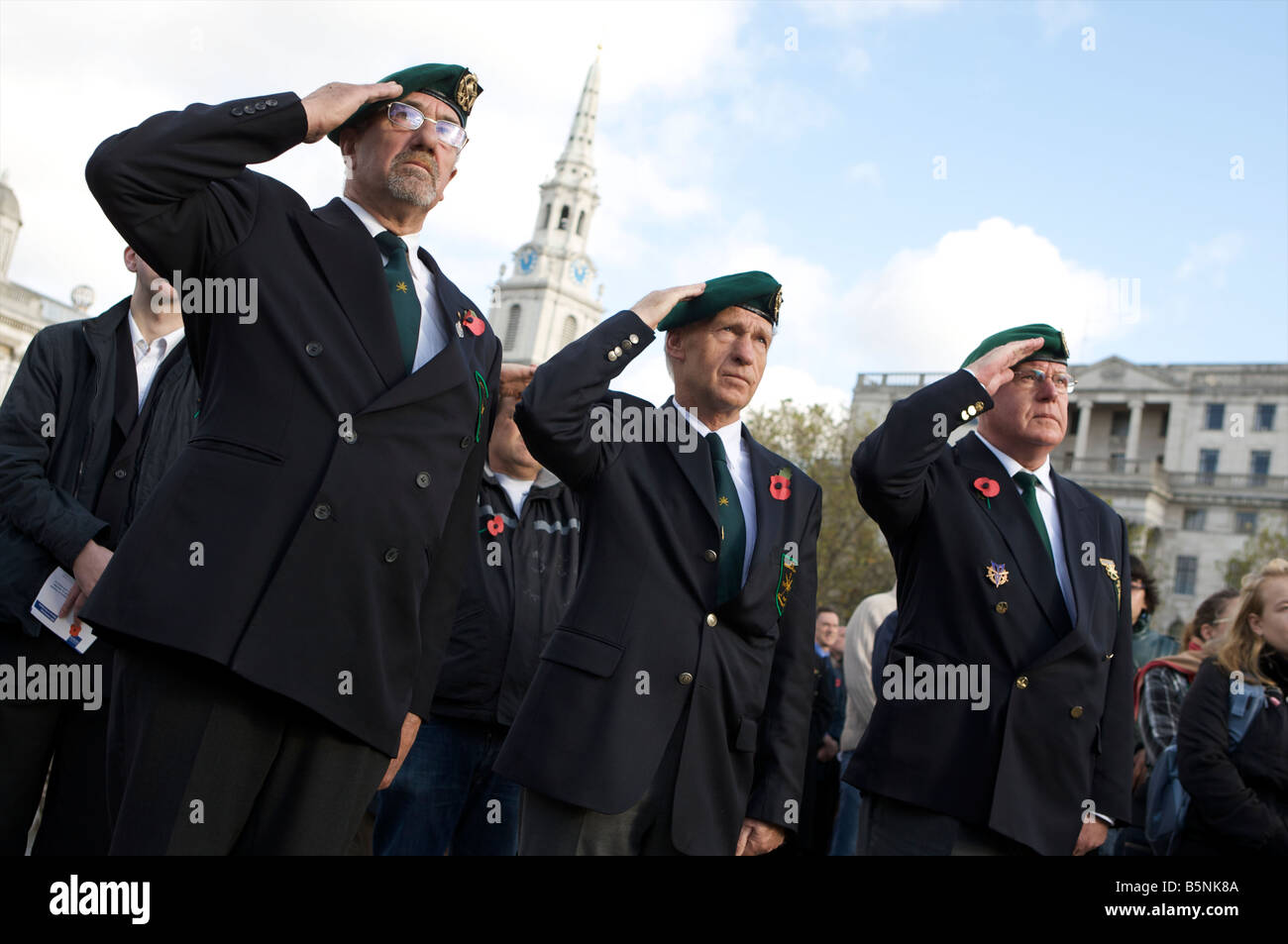 Public and service men at the remebrence day service held at Trafalgar Square placing thousands of poopies in to - Stock Image