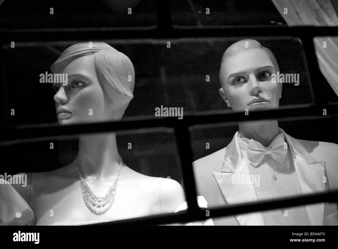 Dummies behind rolling shutter - Stock Image