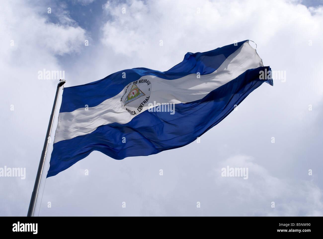 Nicaraguan flag flying in downtown Managua, Nicaragua Stock Photo