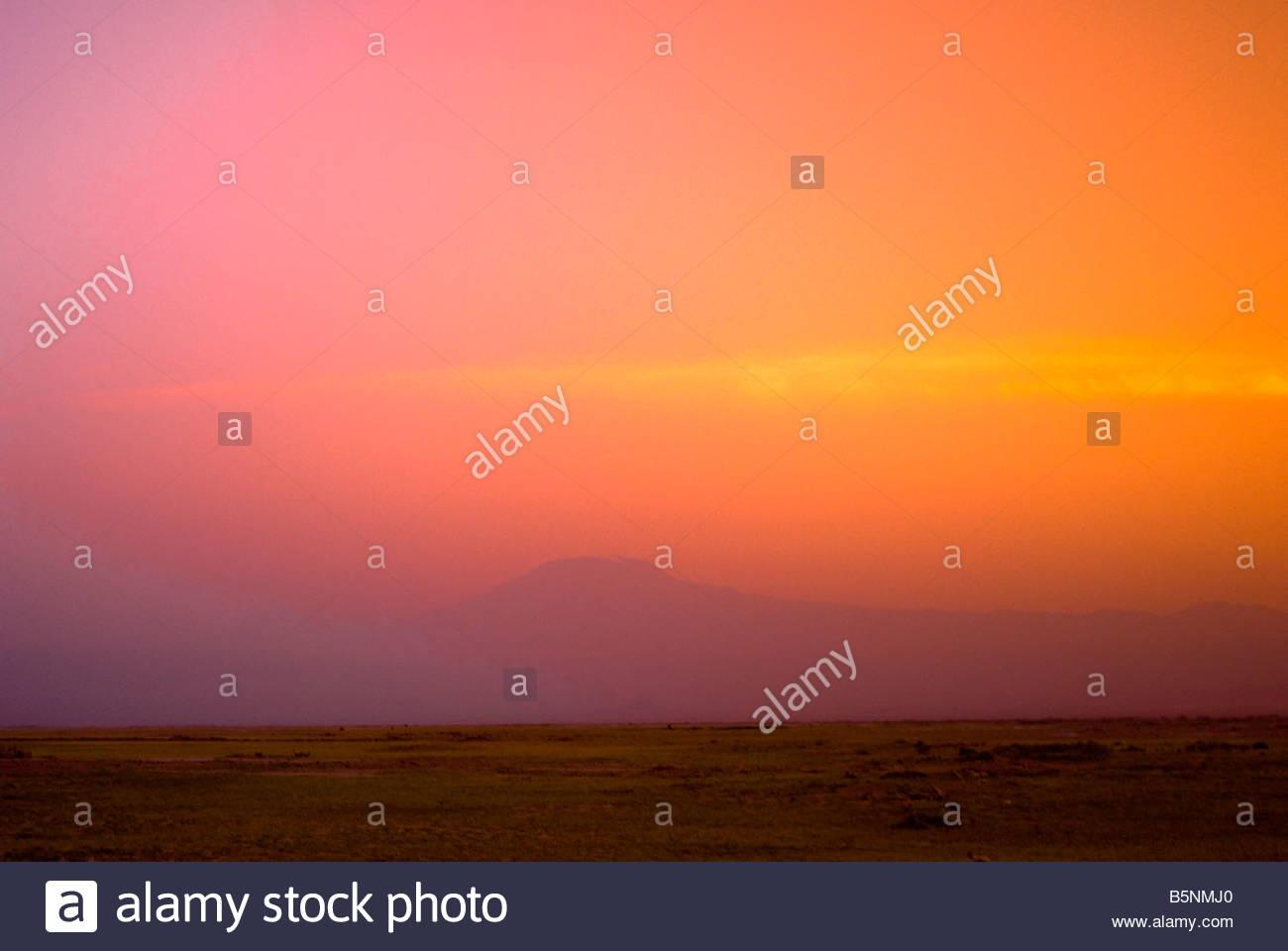 Mount Kilimanjaro at sunset seen from Amboseli National Park Kenya - Stock Image