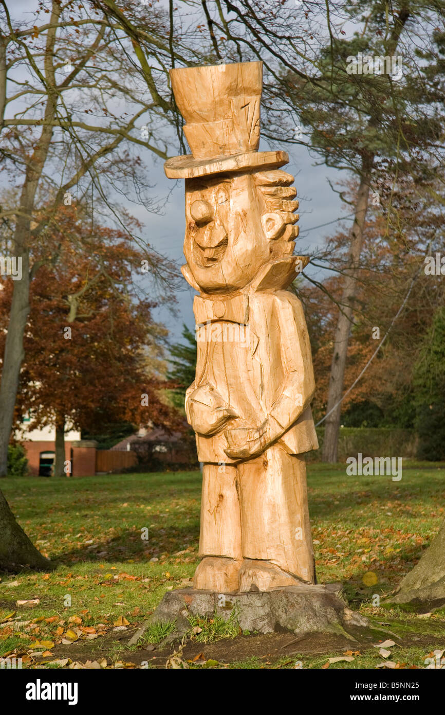 A carving of a tree stump of the Mad Hatter from Alice in Wonderland. Stock Photo