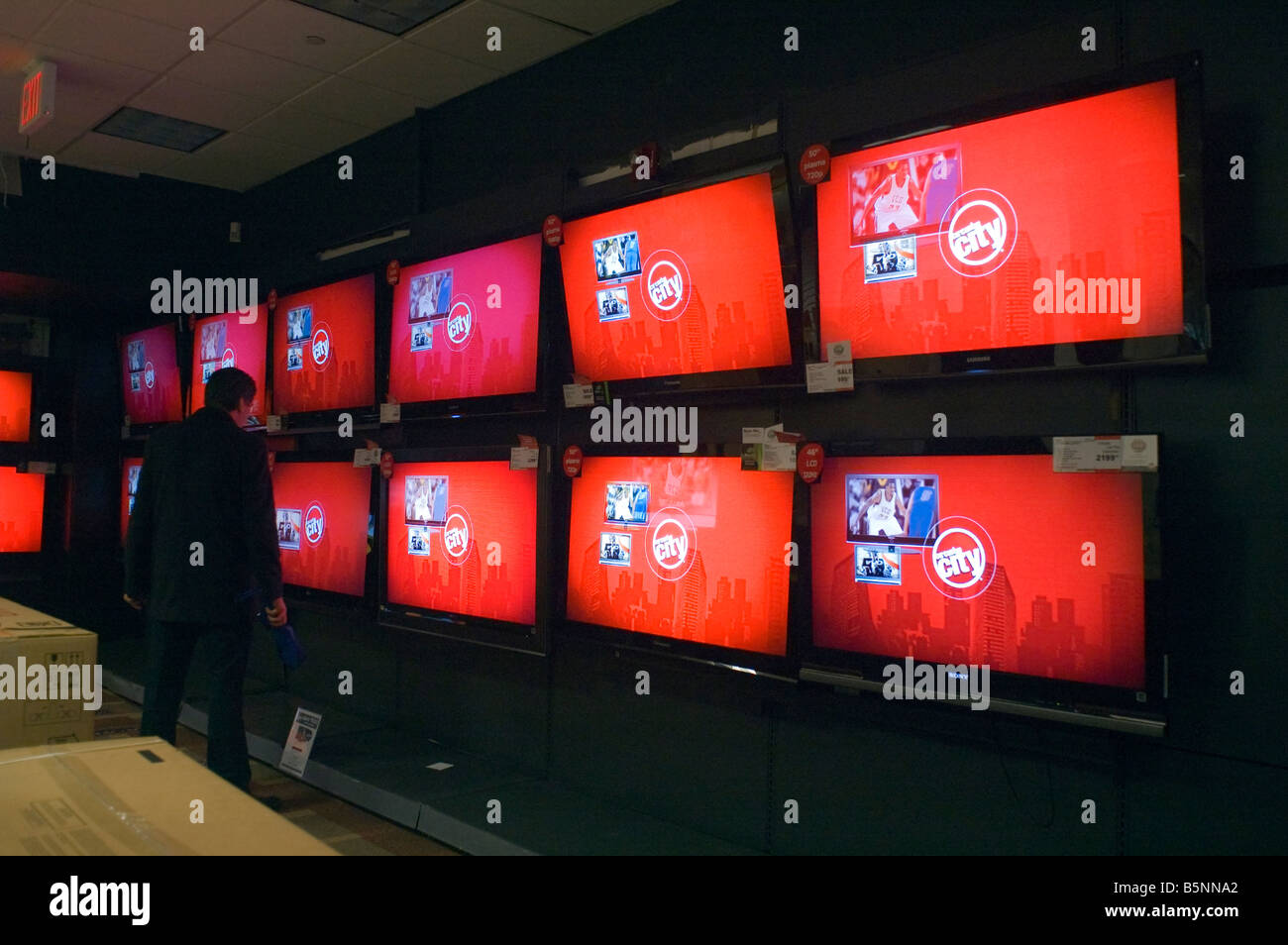 A customer browses the television display in a Circuit City electronics store in New York - Stock Image