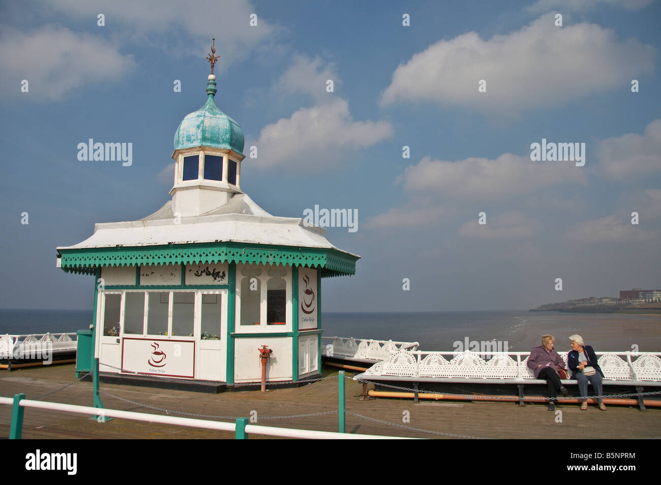 Two women chatting on Blackpool North Pier - Stock Image