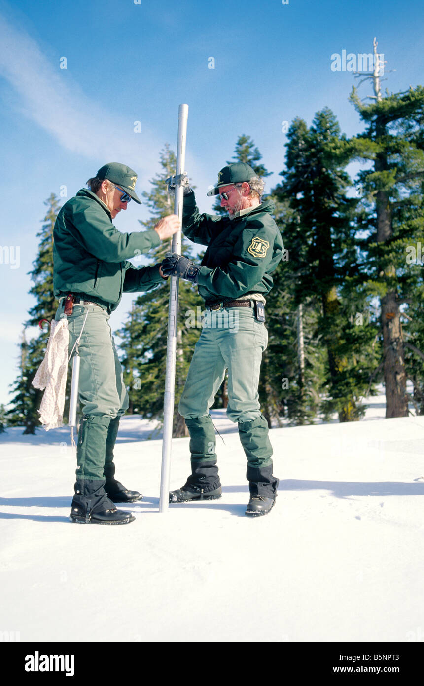 US Forest Service performing snow survey, - Stock Image