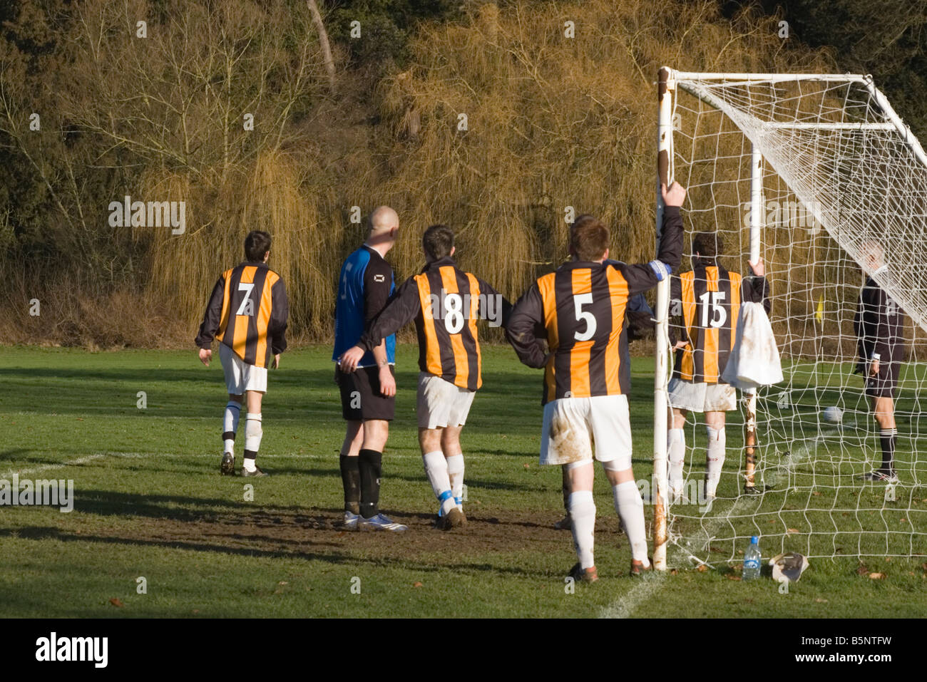 Sunday league Football Match Soccer Players Action Footballers - Stock Image