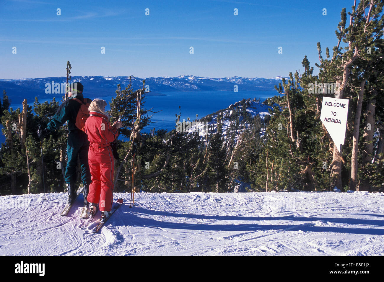 a couple stands at the nevada state line, heavenly mountain resort