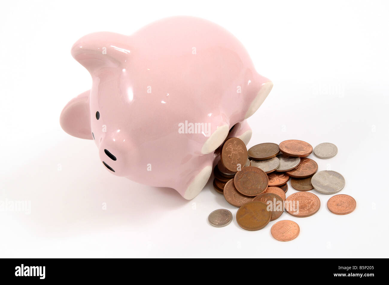 Piggy bank with money coming out - Stock Image