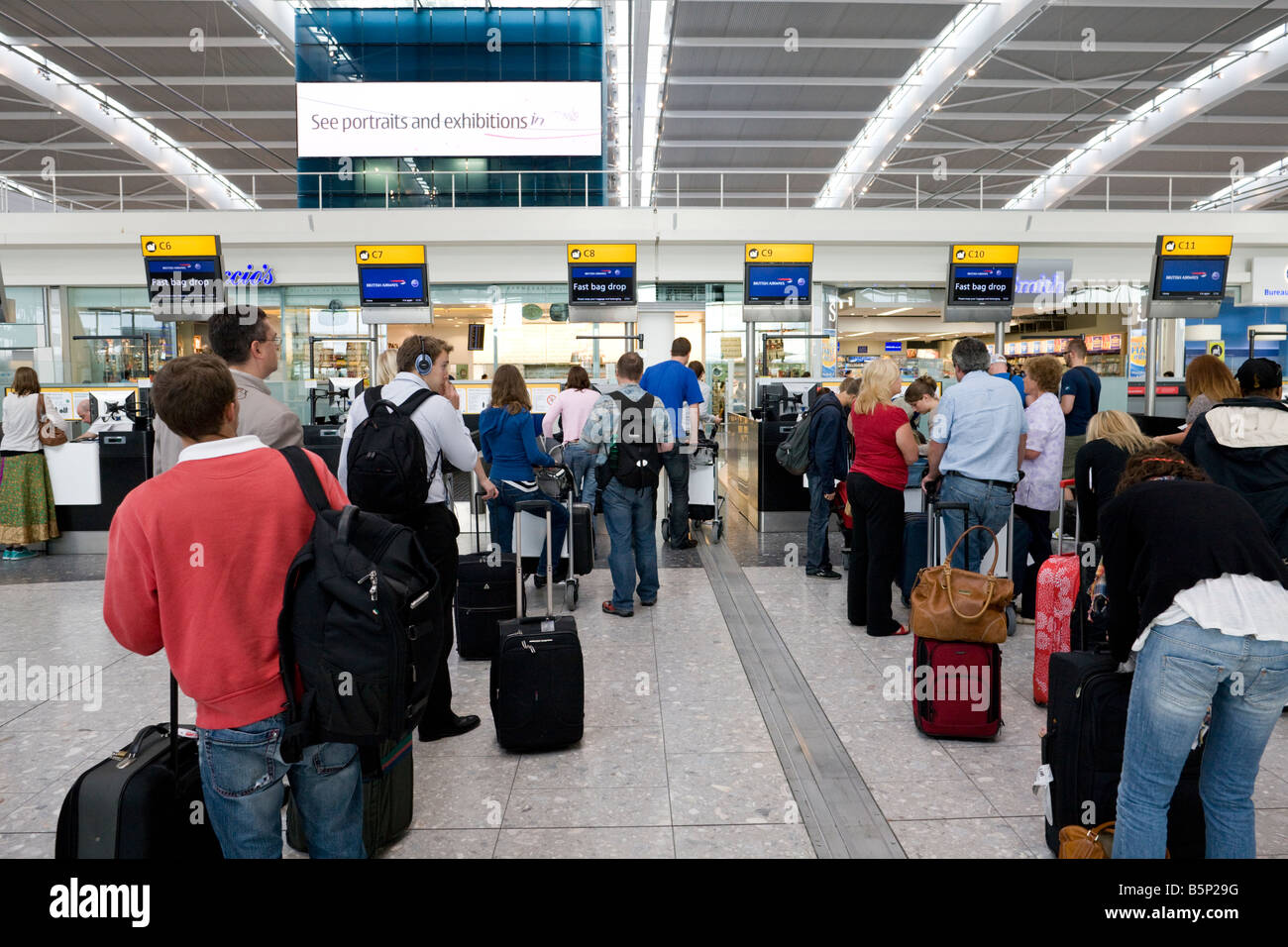 self check in and bag drop, departure level, Terminal 5, Heathrow, London, England - Stock Image