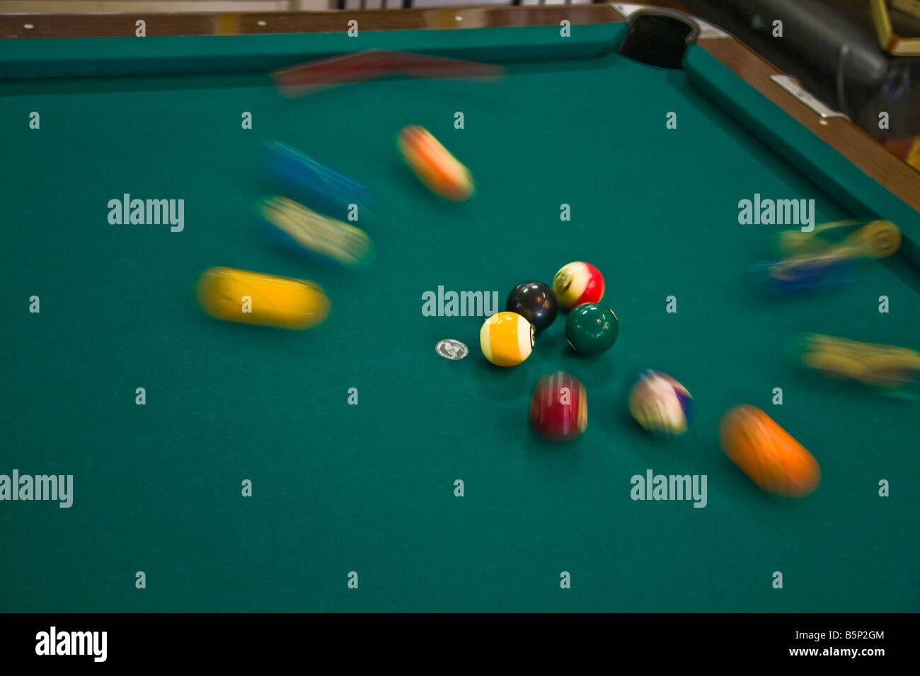 pool hall billiards cue green explode ball shoot concentrate - Stock Image