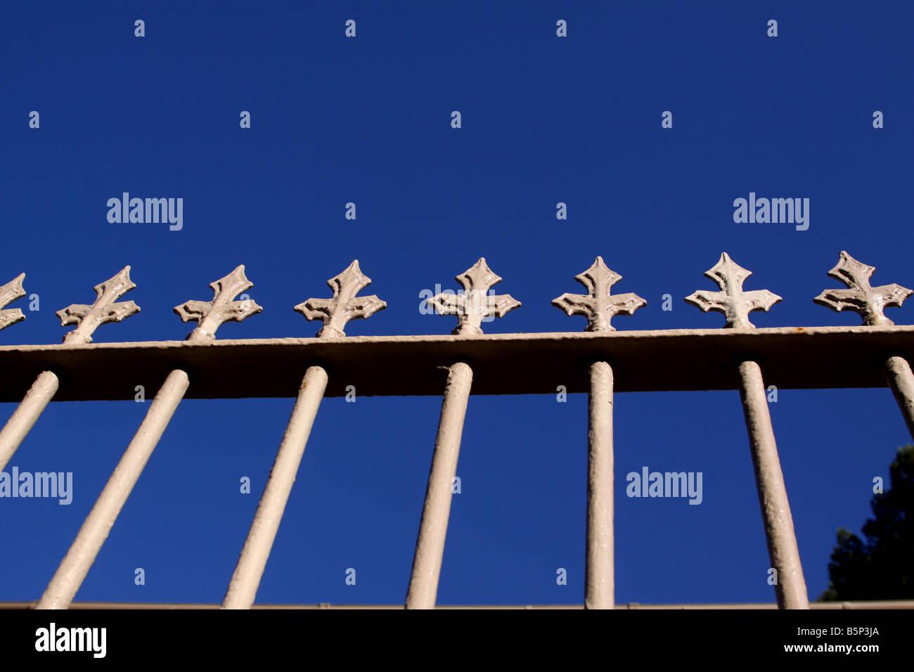 Cast iron railings against blue sky - Stock Image