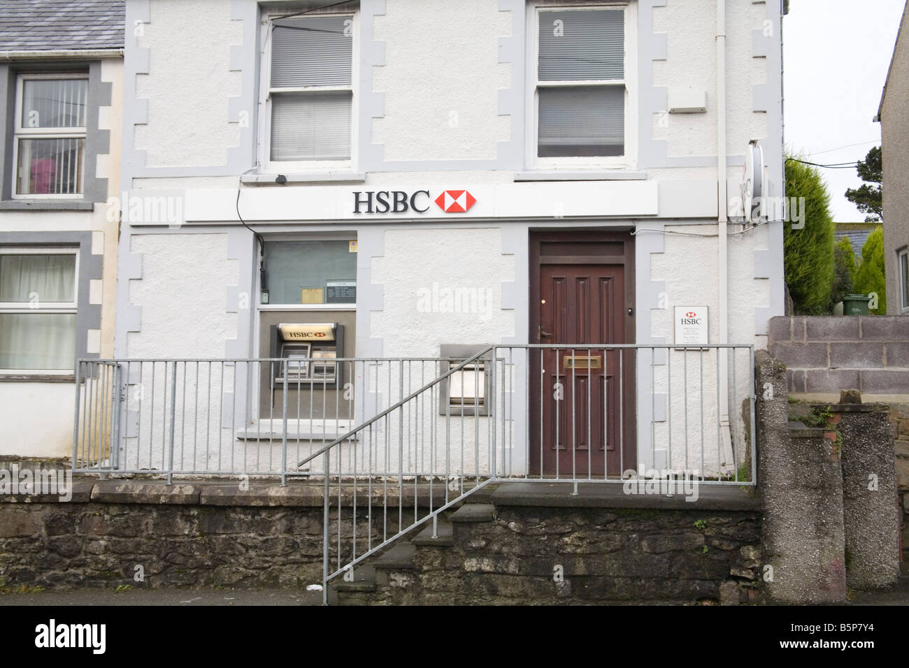 Benllech Isle of Anglesey North Wales UK November Former HSBC village branch with an ATM bank closed to public limited - Stock Image