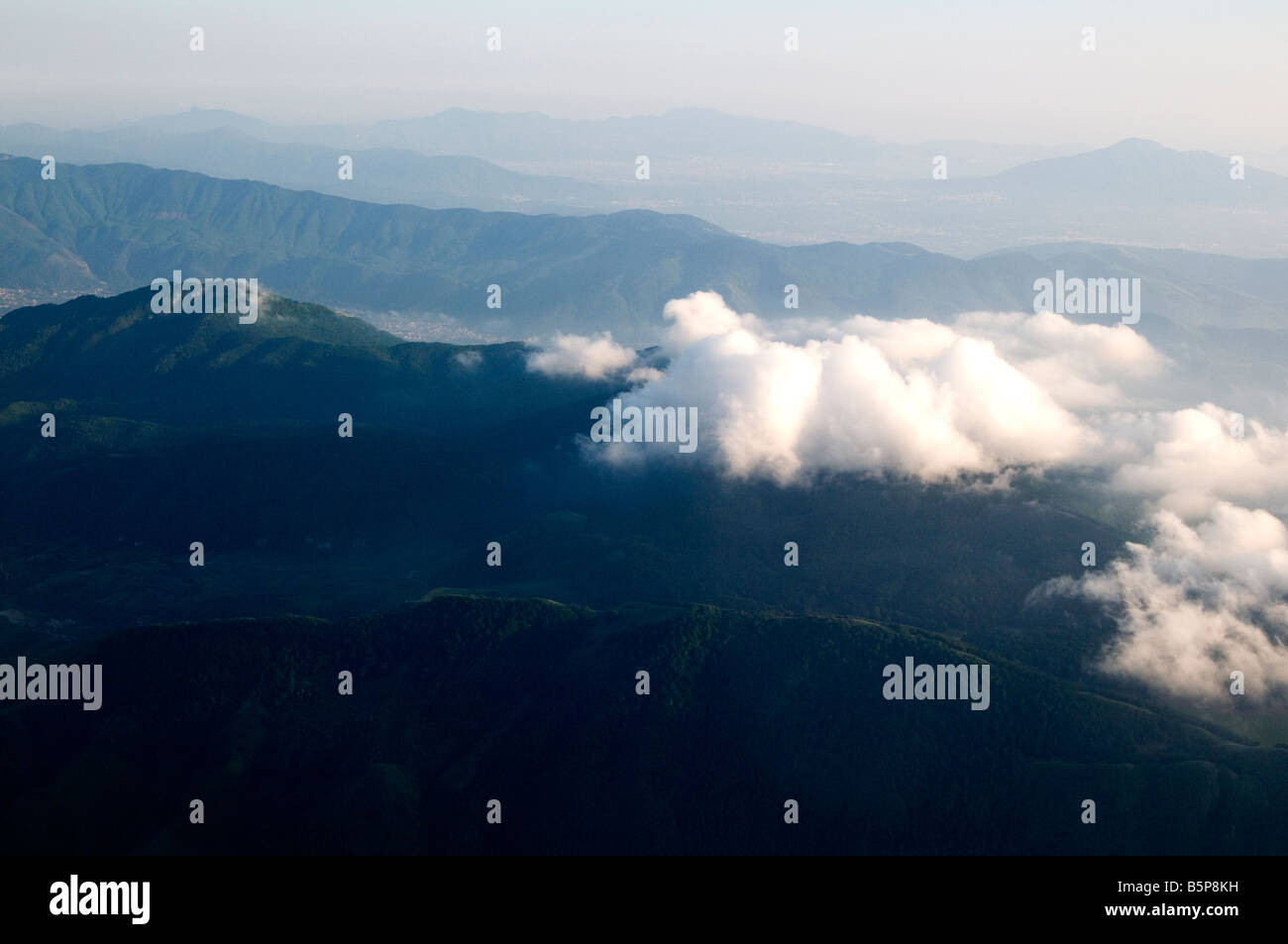 Surreal effects in the clouds as seen while overflying the volcano Vesuvius near Naples, Italy - Stock Image