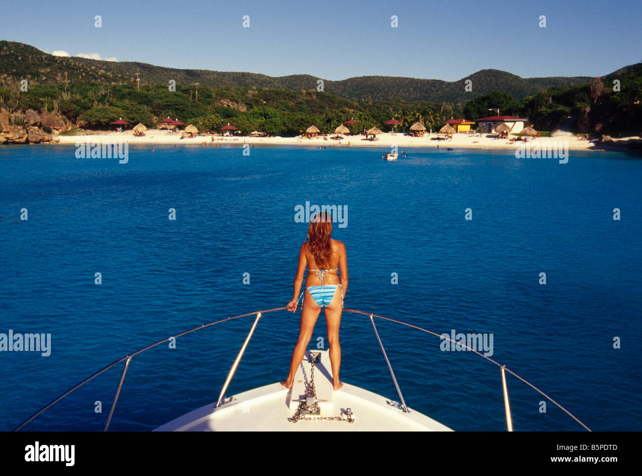 Riding the bow to Playa Knip, off the West End Curacao - Stock Image