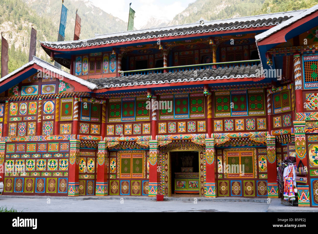 Brightly painted Tibetan tea house in Jiuzhaigou nature reserve Sichuan Province China. JMH3584 - Stock Image