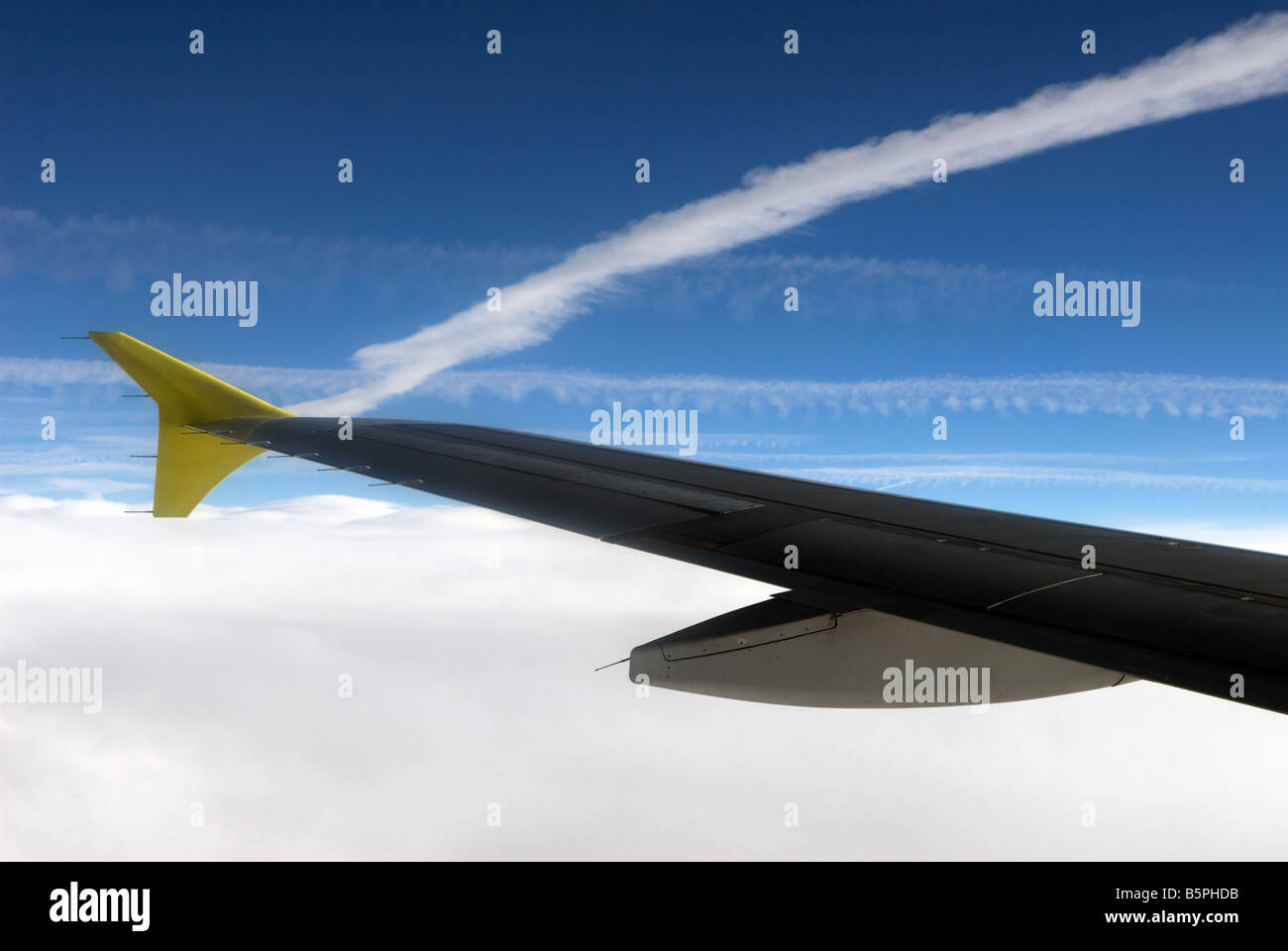 wingtip of a germanwings passenger airliner and vapor trails over the english channel