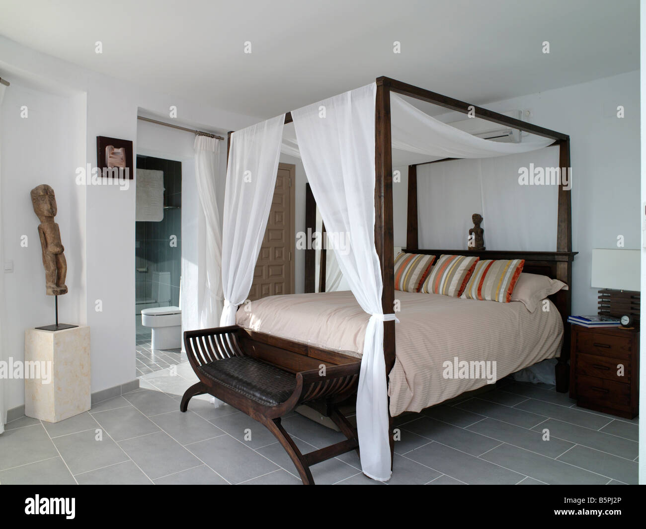 Bedroom with four poster bed in Spanish villa - Stock Image