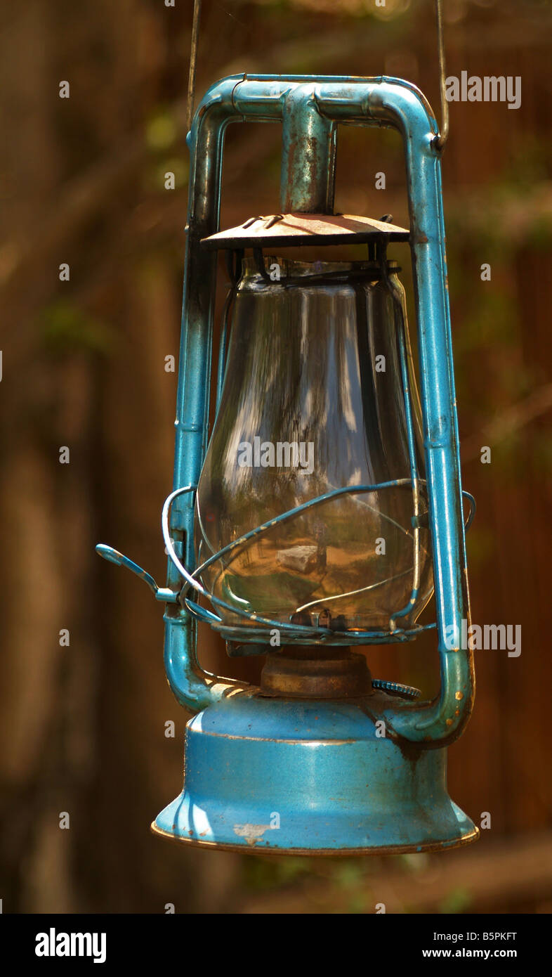 Old blue oil lamp - Stock Image