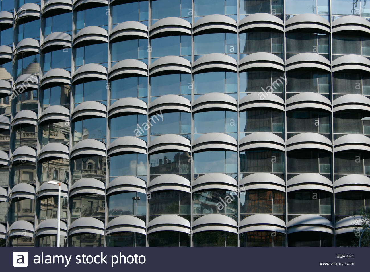 Windows on the facade of a multistorey building - Stock Image