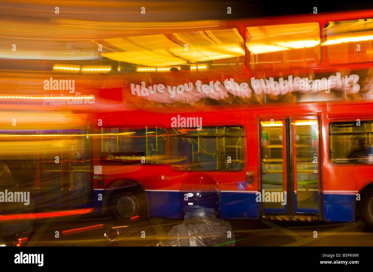 London Bus at Night - Stock Image