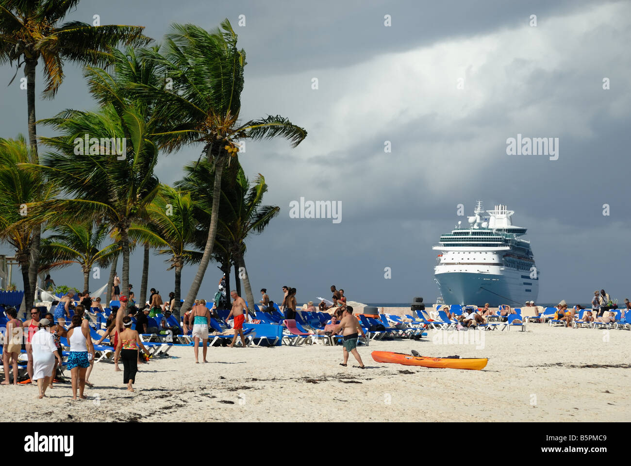 The Royal Caribbean ship Majesty of the Seas can be seen in the distance from the beach at Little Stirrip Cay, Bahamas - Stock Image