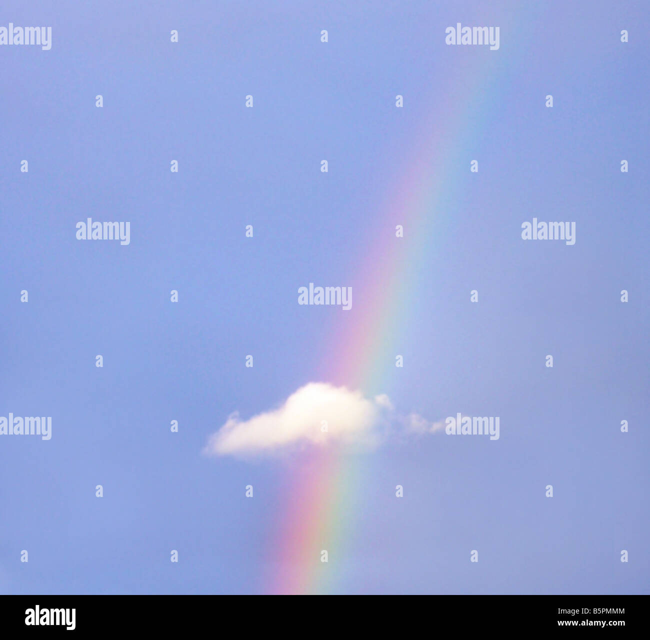 Rainbow with small cloud - Stock Image