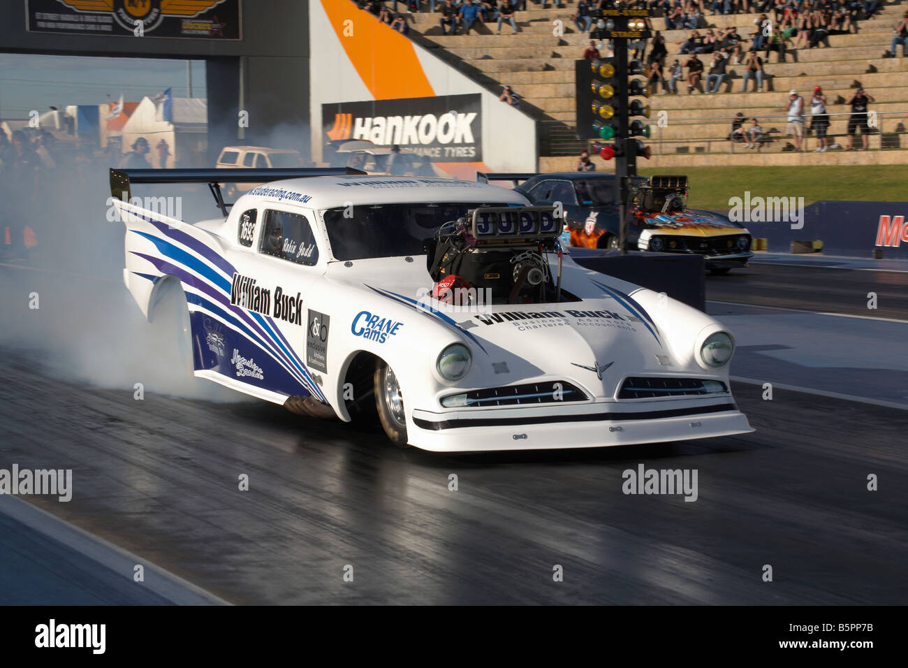 Australian Top Doorslammer drag racing competitor Robin Judd performs a rolling burnout in his 1959 based Studebaker & Australian Top Doorslammer drag racing competitor Robin Judd Stock ...