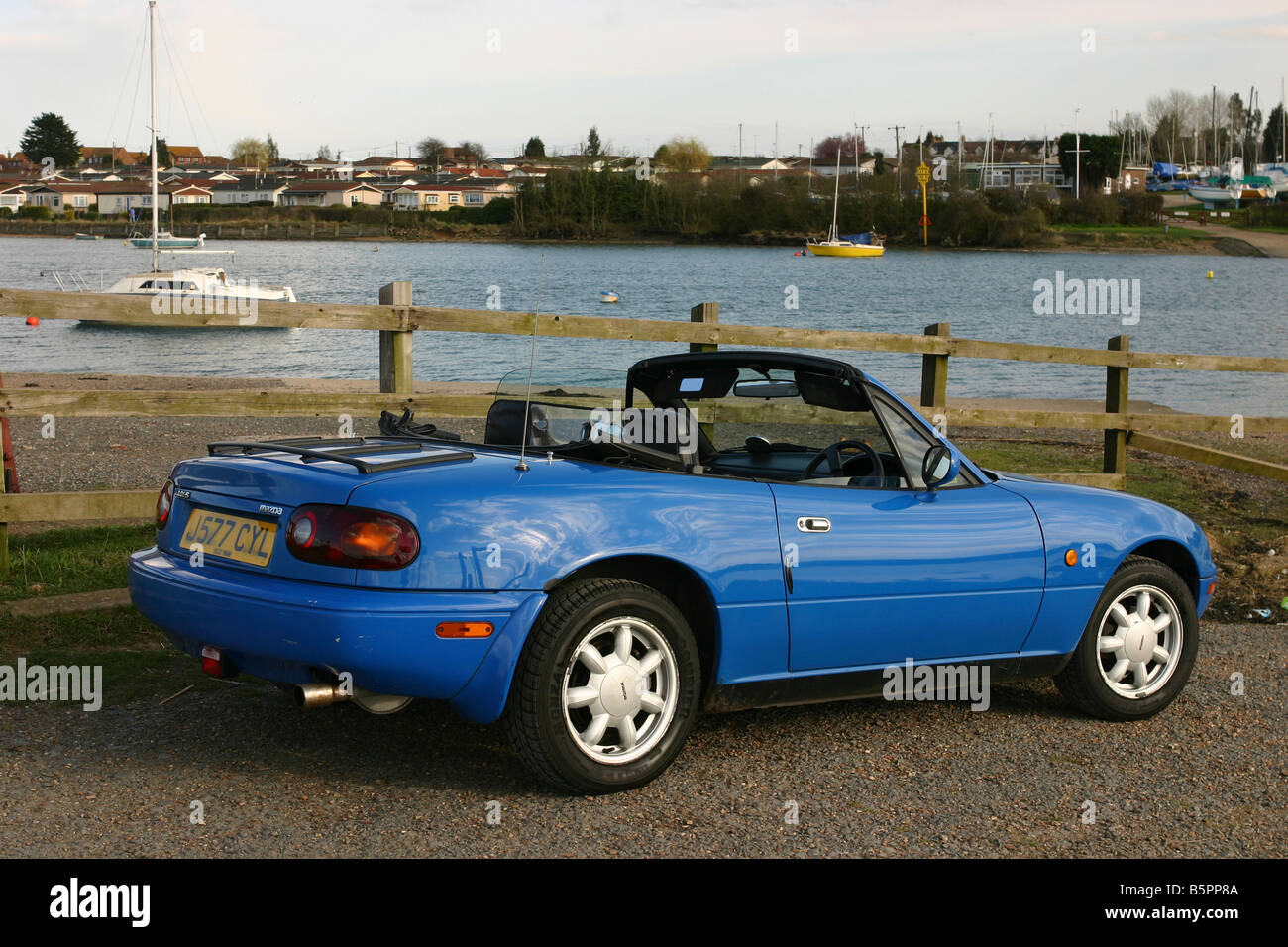 Mazda MX5 Mk1 2 seater sports car with roof down. Riverside setting