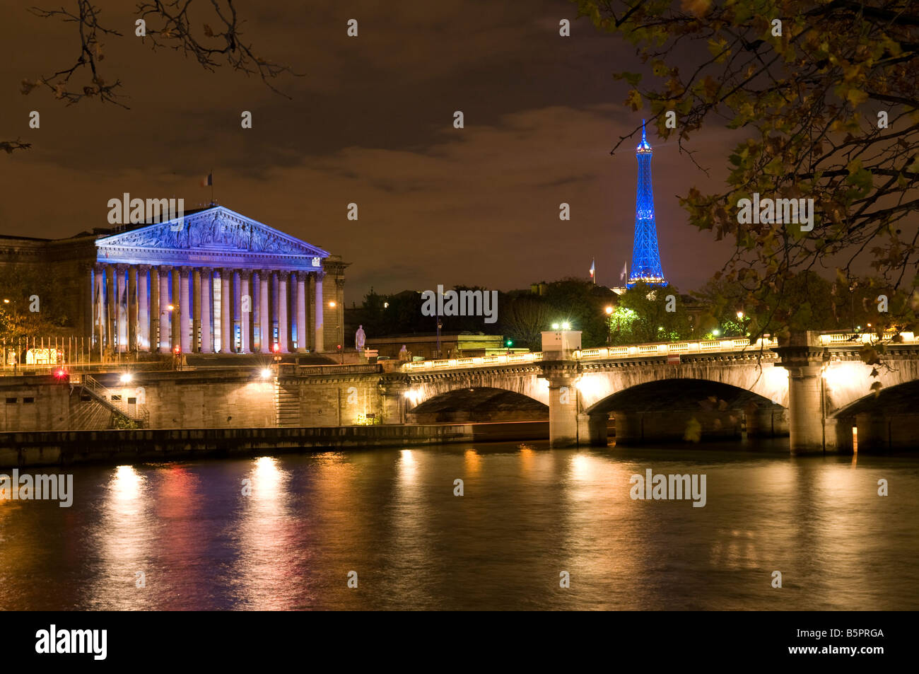 National Assembly Bourbon Palace and Eiffel Tower at night, Paris France - Stock Image