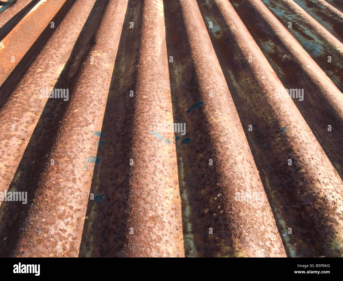Rusty corrugated metal surface. Abstract background texture. Stock Photo
