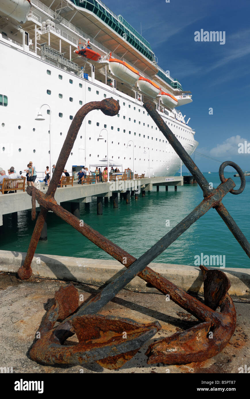 Two old anchors sit on the dock near the cruise ship Majesty of the Seas at Key West, Florida - Stock Image